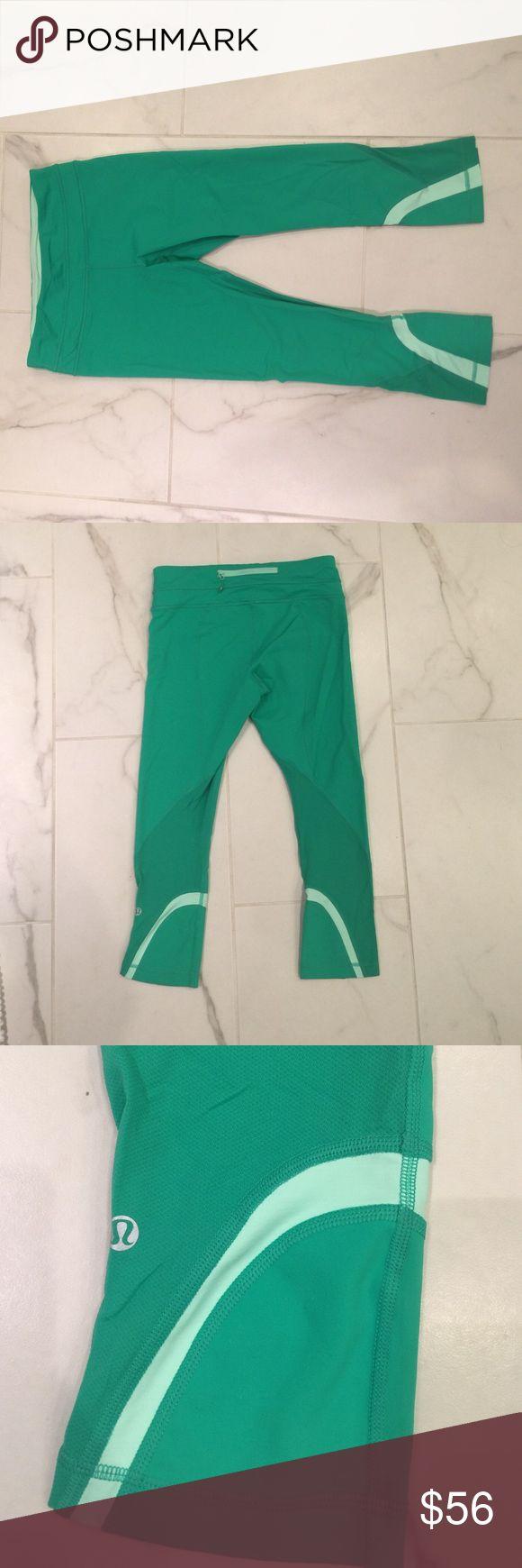 Lulu lemon runinspire crops Green crop leggings with light green detail. Worn few times. Size 6. lululemon athletica Pants Ankle & Cropped