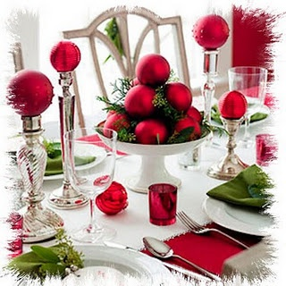 Simple holiday table scape: Ornaments and votive and tall candle holders. LOVE the red, green, silver and white theme!