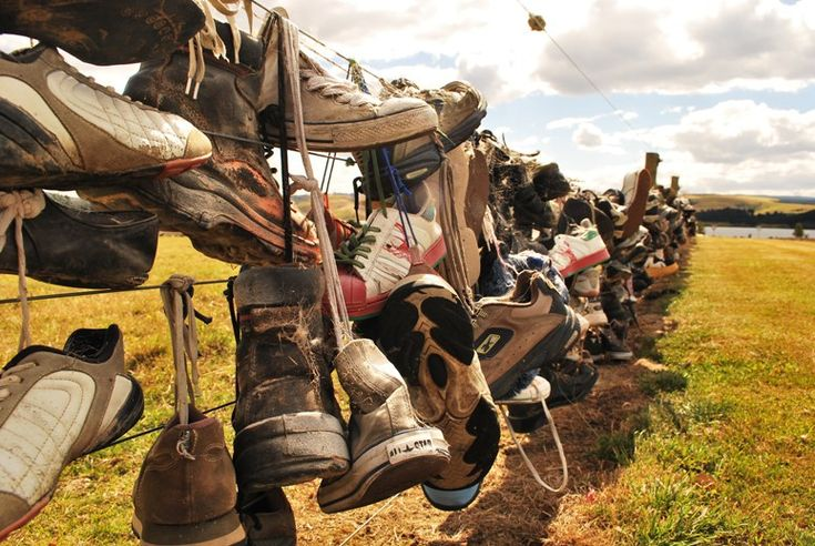 If you're ever driving south of Dunedin towards Invercargill on the south island of New Zealand, you might come across this strange tourist attraction – the Shoe Fence.