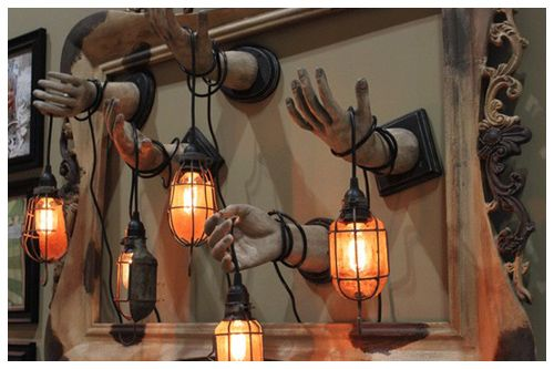 Zombie Lanterns. I might be able to make these. A fake hand, some paint, piece of wood and a lantern...
