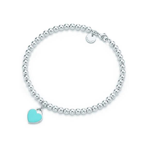 Return to Tiffany® mini heart tag in sterling silver on a bead bracelet. I want this but with a paw print charm.