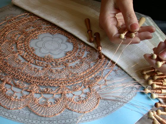 Lenka's bobbin Lacemaking technique with copper wire.