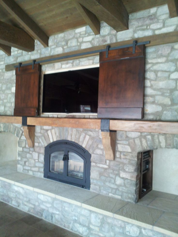 Rolling Tv Barn Doors Concrete Mantel With Hand Forged