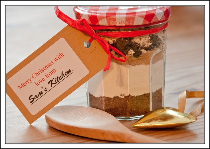 """Re-purposing """"Bonne Maman"""" Jam Jars:  clever gift idea using them for prepared cookie mixes. With that trademark red gingham lid, wide opening and beveled contour glass body, it's a natural pairing with anything from the kitchen."""