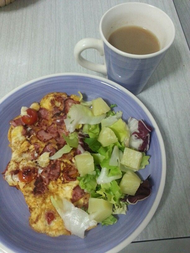Ham and tomato omelette with pineapple salad and nice cup of milk tea