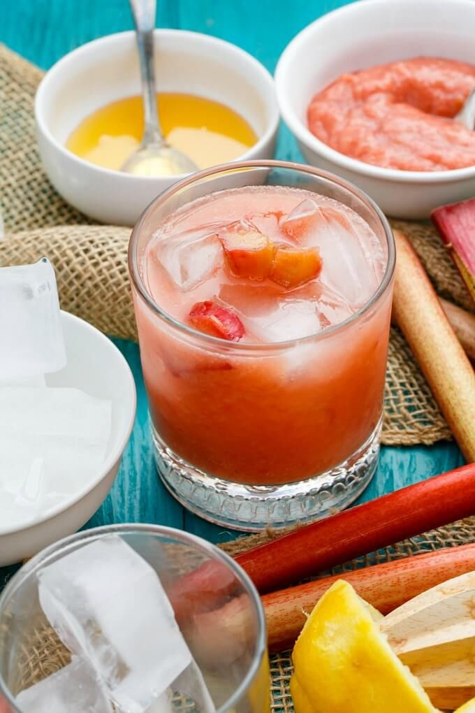 Honey helps bring out the sweet flavours of rhubarb, creating this honey-roasted rhubarb whiskey sour! Vegan, gluten-free, and the perfect summer drink!