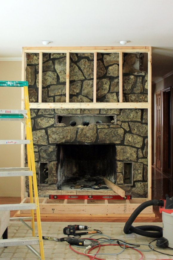 Fireplace build out diy pinterest fireplaces and - How to cover brick fireplace ...