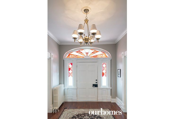 Coloured glass panels and a fan light of the same vintage flank the home's original front door.   See more of this home in OUR HOMES Peterborough Early Summer 2016 http://www.ourhomes.ca/articles/build/article/180yearold-cobourg-loyalist-home-restored