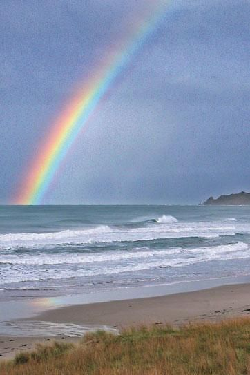 Rainbow at Wainui Beach in Gisborne, North Island, New Zealand. Original source unknown.