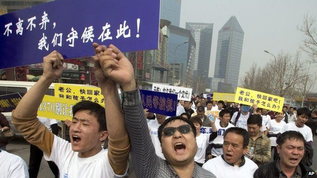 Malaysia Airways MH370: Relatives in Beijing clashes - Source - BBC News - © 2013 BBC #Malaysia, #BeijingClashes