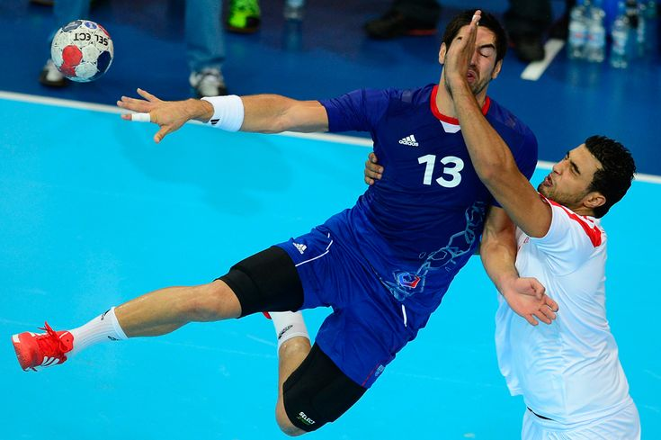 France's centreback Nikola Karabatic vies with a tunisian player during the men's preliminary Group A handball match France vs Tunisia, Aug. 2, 2012 at the Copper Box hall in London. (Javier Soriano/AFP/GettyImages) #