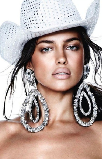 Irina Shayk okay..the hat is vile...true hen night/stripper style but the earring are pure CHER!!! <3 the earrings.