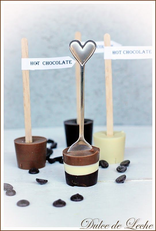 Hot chocolate dippers:  melt your favorite chocolate, cool slightly and pour into a dixie cup, insert a spoon or chopstick or stirrer or whatever and wrap pretty as a gift.  To use, just stir around in a cup of hot milk.  These are just begging to be Christmas goodies. - considering this for coworkers!