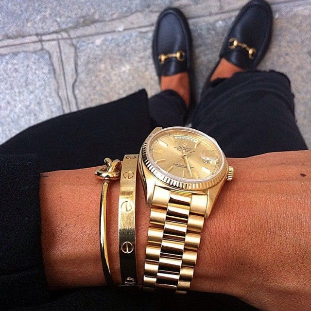 Gucci Loafers, Cartier love bracelet, Rolex watch, Celine knot bracelet