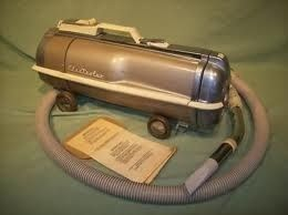 My mother had one of these, I used to follow it around when she vacuumed, for the breeze :)  Old canister vacuum