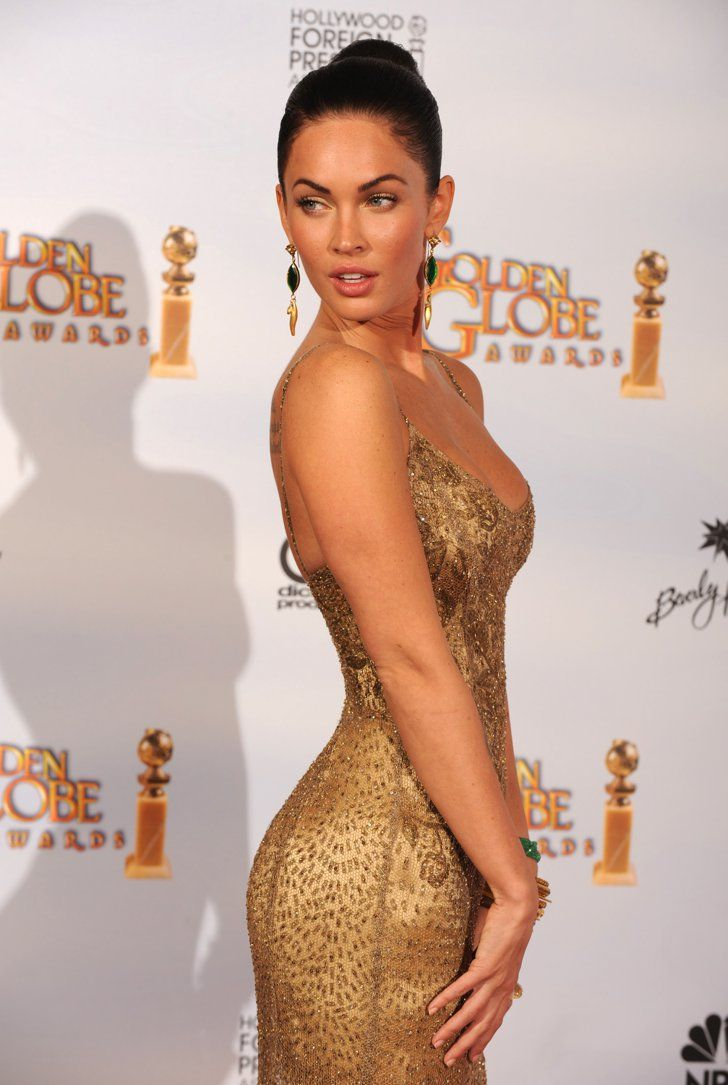 Pin for Later: Excessive Heat Warning: Megan Fox's All-Time Sexiest Looks Megan Fox in Ralph Lauren at the 2009 Golden Globes Emerald drop earrings and a sleek updo completed her red carpet look.
