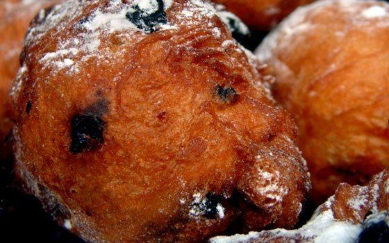 Dough balls - Dutch recipes - Oliebollen, literally translated as grease balls, are deep fried dough balls, studded with raisins and currants, and sweetened with a generous dusting of powdered sugar. It is traditional to serve oliebollen with coffee during this time of year.