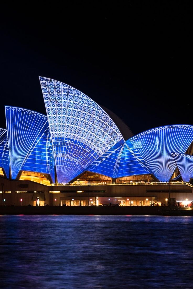 Blue Lighted Sydney Opera House during Nighttime