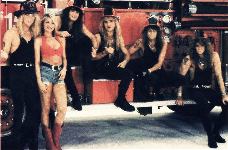 Warrant with video vixen, Bobbi Brown during the video shoot for Cherry Pie. 80s