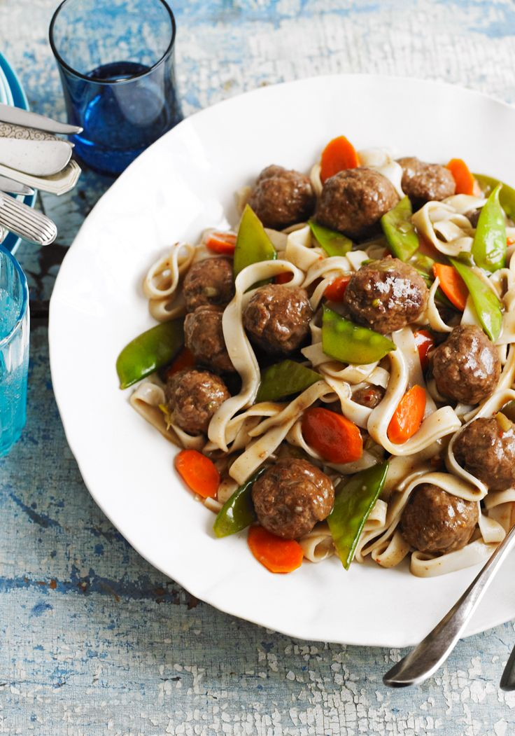 """Asian """"Spaghetti"""" & Meatballs- Full of veggies, this substantial dish combines spicy meatballs, Chinese wide noodles (lo mien) for an Asian twist to an Italian favorite."""
