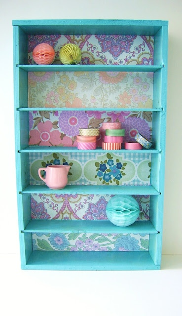 Mod podge different vintage wallpapers for each level to make this cute book shelf! (can do with boxes shelf)