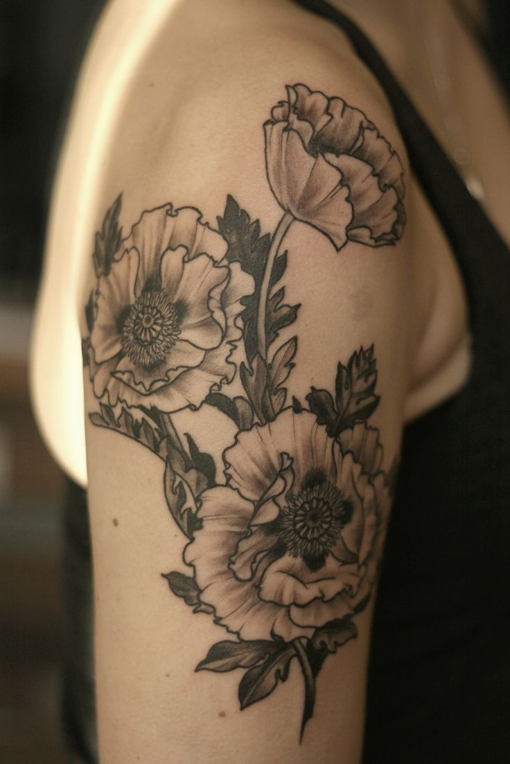 Alice Carrier floral tattoo