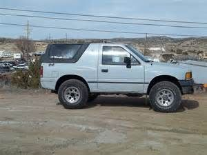I had a 1989 Isuzu Amigo. Another one! Yes the same color (I loved that 'cloud gray' color) and this one was a proper 4x4! Also I had managed to find a Factory optional fiberglass tonneau cover (yay recycler!) I have never seen another like it, and it was very good looking!