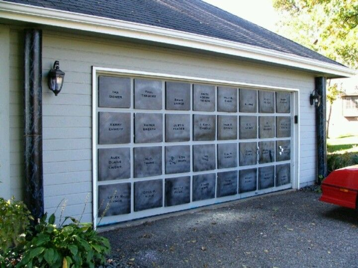This is awesome, mausoleum treatment for your garage door! Halloween decor