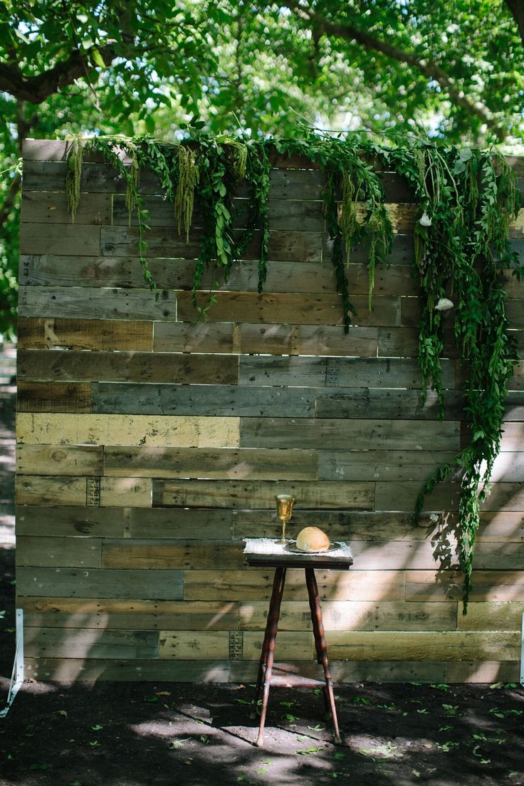 Rustic wooden wall constructed for wedding #ceremony #backdrop | See the wedding on SMP: http://www.StyleMePretty.com/2014/02/05/casual-walnut-orchard-wedding/Abi Q Photography