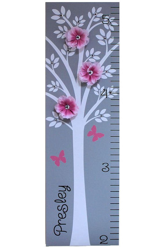I do have fun adding bling to the little girl things! This beautiful modern tree growth chart comes with rhinestones and real silk flowers with