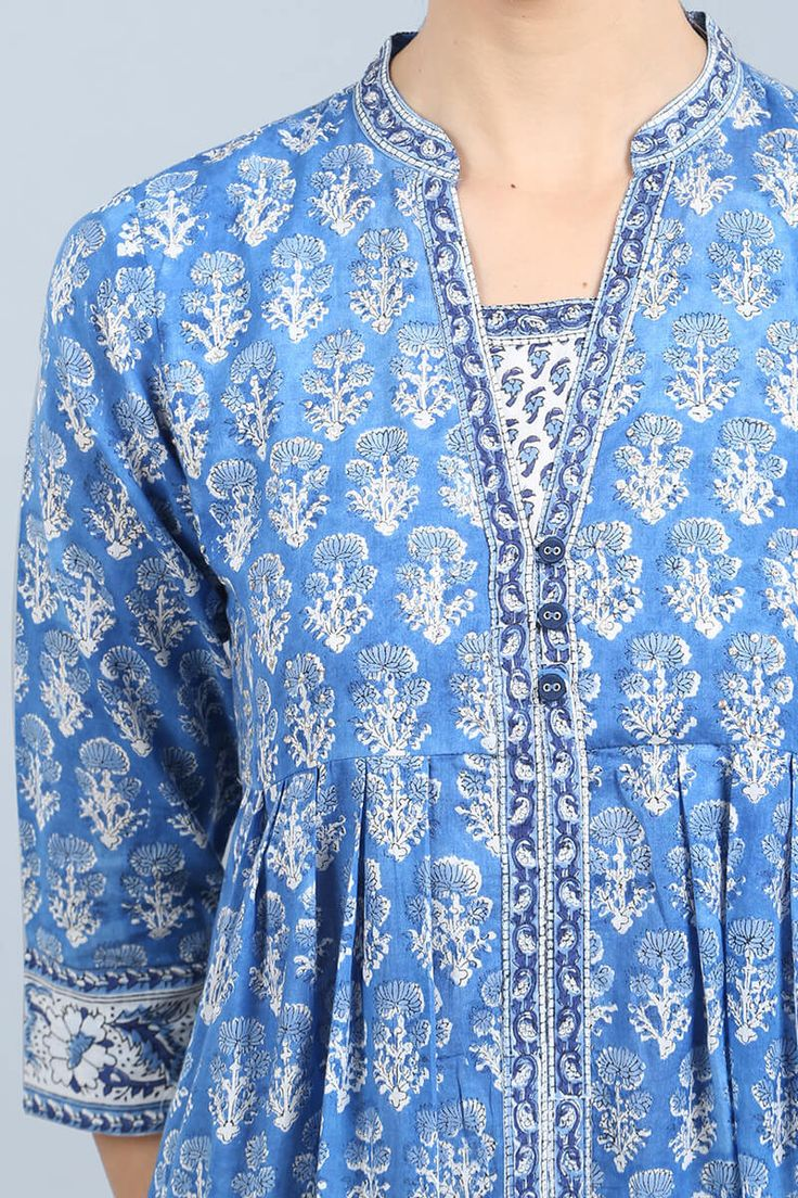 Bring in the spring cheer with the Niloufer Hydri Kurta from our latest collection. This blue and white A-line kurta has a trendy box-pleat design that gives it a beautiful fall. The yoke is highlighted with intricate sequins and thread work and make the