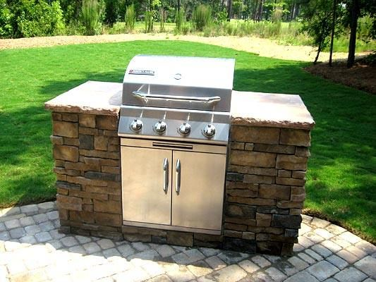 Outdoor grill surround chloe couldn t knock it over as for Built in barbecue grill ideas