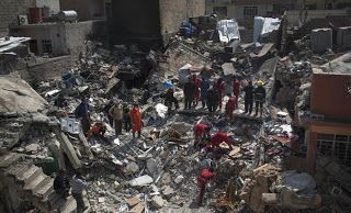 The Juciest Blog in Town: Iraqi military says 61 bodies pulled from collapse...