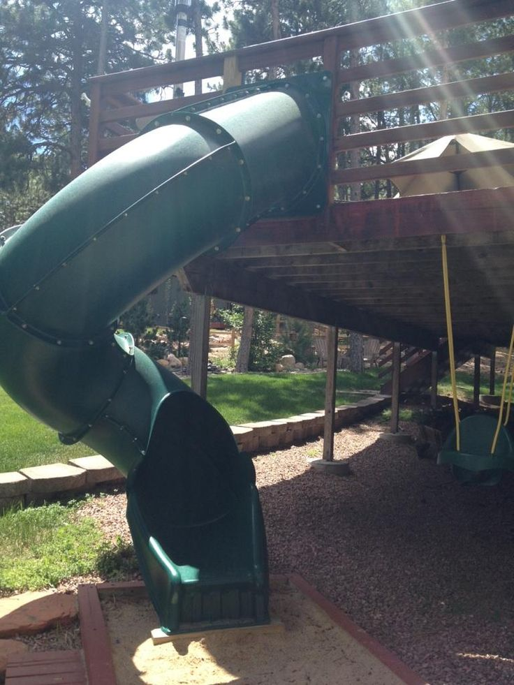 Slide and swing attached to house deck!  Great Idea! (from my friends backyard)