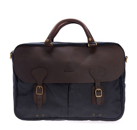 Barbour Wax Leather Briefcase. Combining business-ready functionality with Barbour's signature waxed finish, the Wax Leather Briefcase is a robust commuting companion. This laptop-sized briefcase is crafted with a waxed cotton outer, real leather trims and antique brass hardware. The cotton lining in Barbour's iconic Classic Tartan adds unmistakable authenticity, while two leather carry handles are complemented by a detachable webbing shoulder strap for extra practicality.