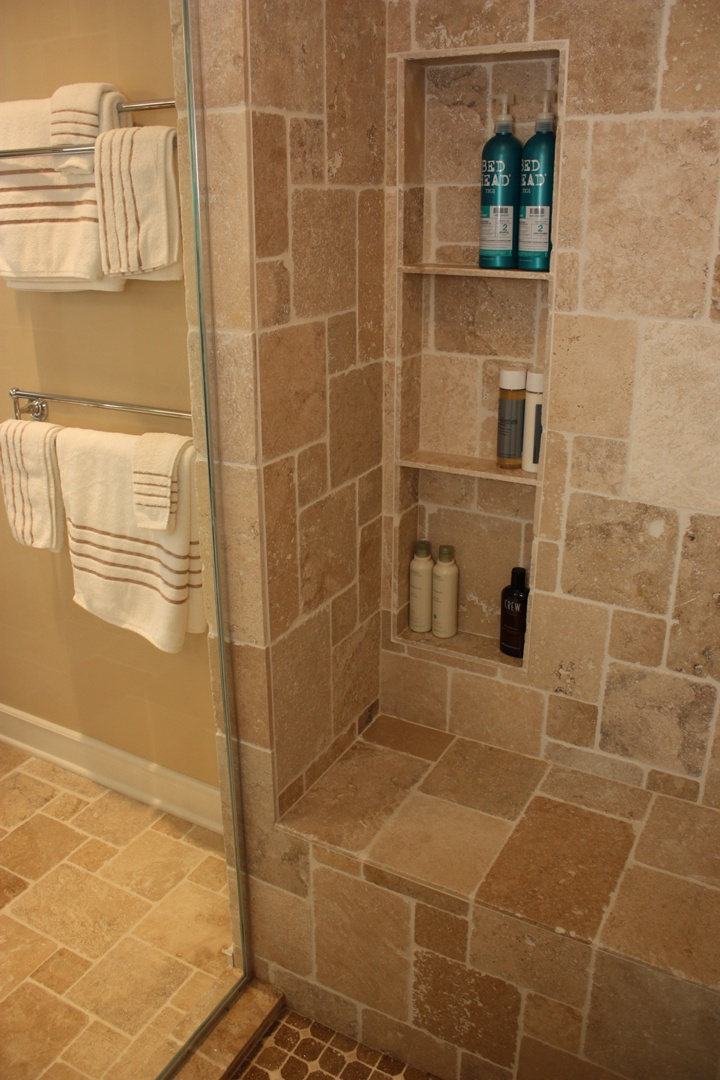 Bathroom design by matthew krier of design group three for Bathroom built in shelving ideas