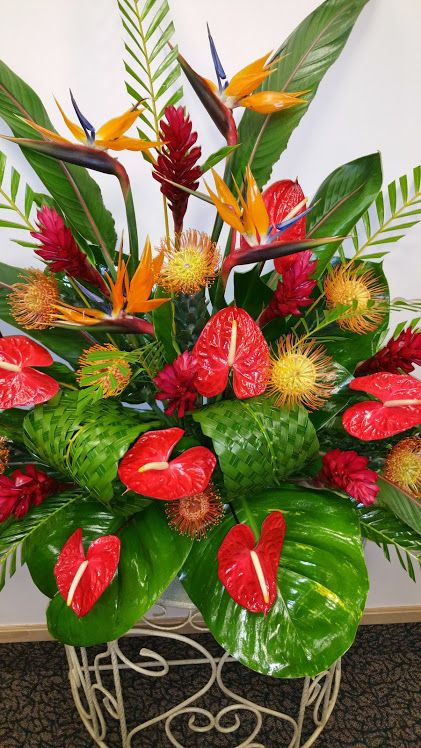 Another beautiful Hawaiian Flower arrangement made with Hawaiian Anthiriums, Bird of Paradise,Hawaiian Red Ginger, Hawaiian Protea and handwoven tea leaves