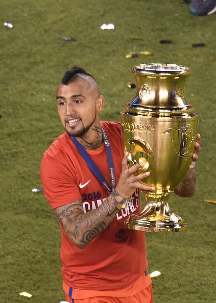 #COPA2016 #COPA100 Chile's Arturo Vidal celebrates with the trophy after winning the Copa America Centenario final by defeating Argentina in the penalty shootout in...