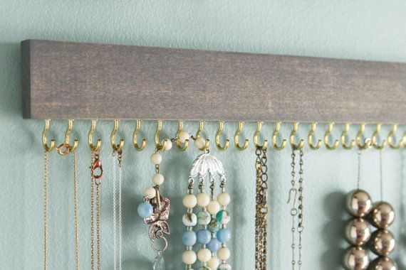 One driftwood gray stained and waxed wood necklace display with 23 hooks - either gold (brass) or silver (nickel). 12 long by 2 tall (including hooks). Please keep in mind that grain pattern varies quite a bit and affects how the stain will appear.  Two sets of Command Velcro strips for hanging on the wall are included, one for each side of the display. Ive used mine quite a bit and found it to be very sturdy - and removable!  Please read 3Ms instructions on cleaning your walls and applying…
