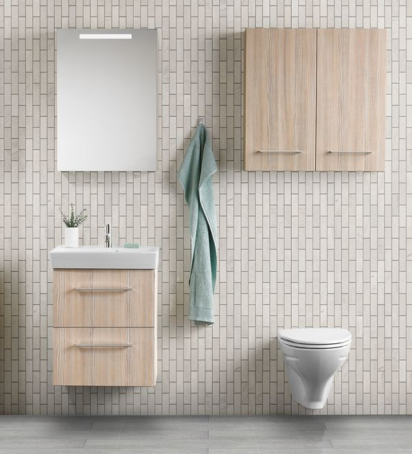 Use the space over the toilet bowl in the small bathroom or cloakroom for a wall unit or two.