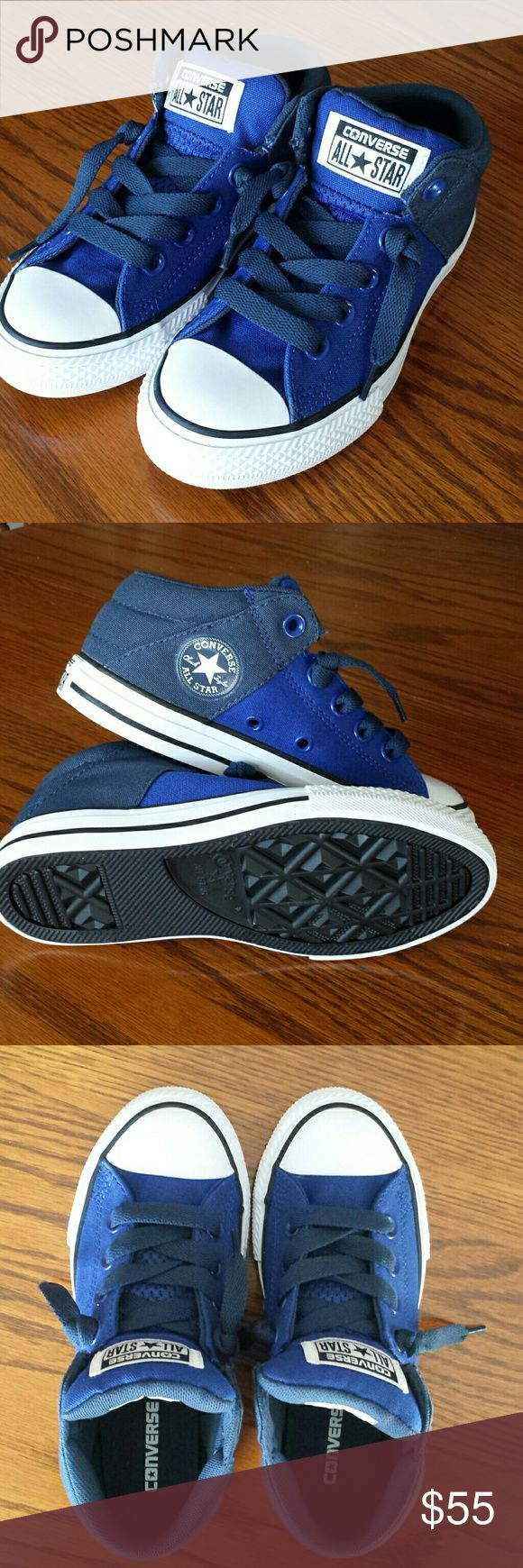Royal blue Converse Kids new chucks for boys and girls. Between a hi top and low. Has extra padding on tongue and heel wall. Received as a gift but too small. These are new, never been worn. Converse Shoes Sneakers