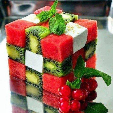 Instructions: 1. Cube Watermelon, Kiwi, and Feta cheese 2. Alternate the fruit and cheese pieces 3. Break off toothpicks and place them down the center to hold the cubes in place. 4. Garnish with spearmint sprigs.