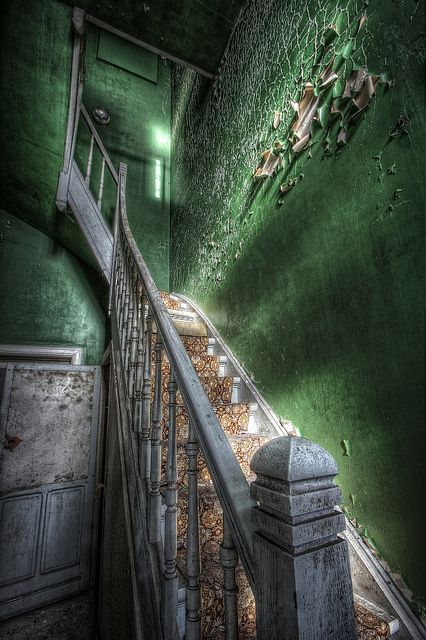 Lovely staircase in an abandoned home.  Love the green peeling wall.