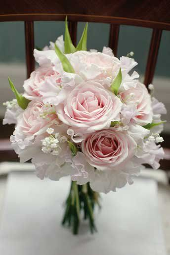 Bouquet of lily of the valley, sweet peas and 'Avalanche' roses by Flowers By Passion