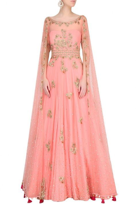 Monika Nidhii - Featuring a surreal rose color flared gown in net with scattered sequins all over and gold embroidered floral motifs along with cape sleeves and pom poms around hem.