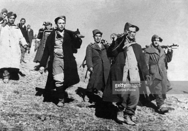Greek rebels leaving to attack, in the Grammos mountains, close to the Albanian border.