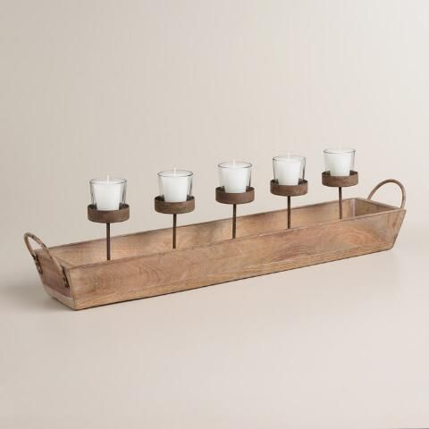 Handcrafted of graywashed mango wood with metal handles, our candleholder makes a rustic dining or coffee table centerpiece, illuminating gatherings with the inviting ambience of five votives. Fill the tray with stones or sand to achieve a natural look.
