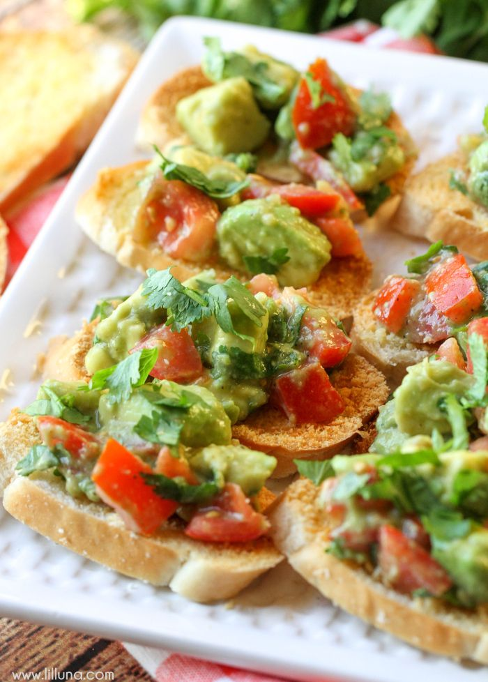 Guacamole Bruschetta - a simple, quick and delicious appetizer filled with tomato and avocados!