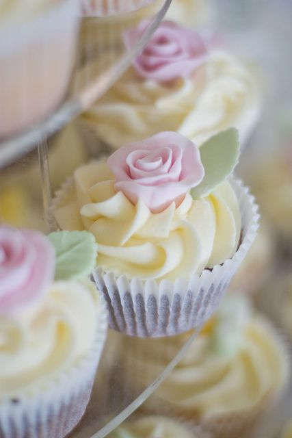 Skip the traditional wedding cake and feed your guests with these individual country garden flower themed cupcakes.