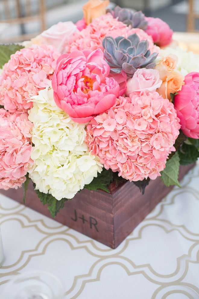 lush arrangement in a wooden box makes a gorgeous centerpiece.